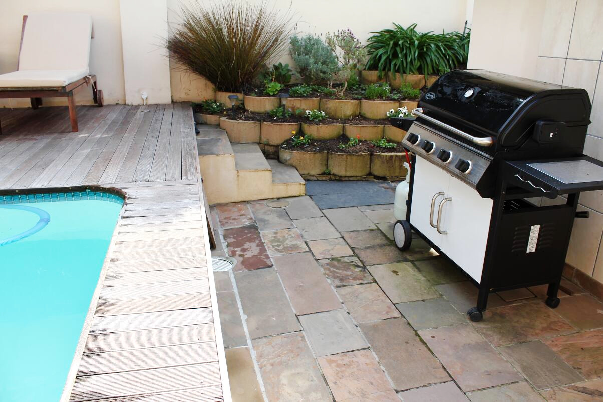 A barbeque or braai by the pool
