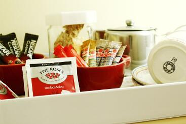 Red roses tea, rooibos and rusks